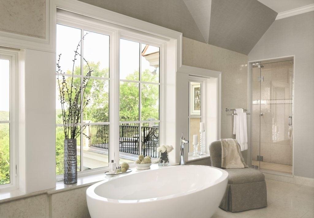 Jill Shevlin Design Vero Beach Interior Designer A modern open bath with a freestanding tub