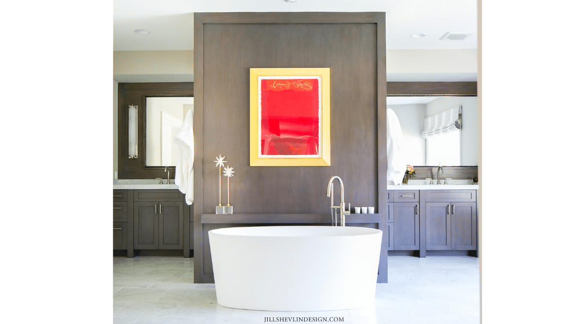 Marble Master Bath with Warm toned custom cabinets and freestanding tub of a californai home remodel by interior designer Jill Shevlin from Vero Beach, Florida